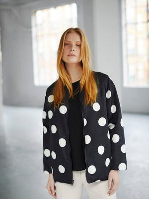 Polka dot reversible quilted jacket, black on the inside, €79; cream straight leg trousers, €79, available March