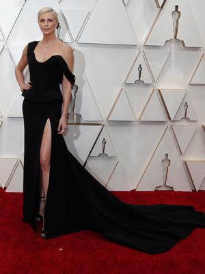 Charlize Theron poses on the red carpet during the Oscars arrivals at the 92nd Academy Awards in Hollywood, Los Angeles, California, U.S. REUTERS/Eric Gaillard