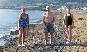 Happy to be back: Margaret Boles, Les Scanlon and Linda Uhlemann of the Bray Beach Bathers before their daily swim. Photo: Gerry Mooney