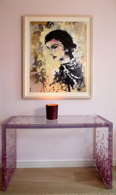 The console table, made of real petals embedded in resin, is by Sasha Sykes of farm 21, while the painting of Coco Chanel is by Katarzyna Gajewska