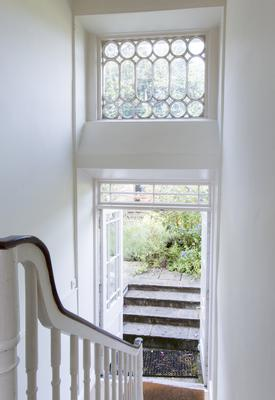 A detail of the stairs from the living level down to the door to the garden