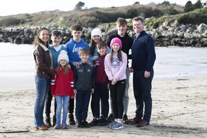 Geraldine Meade with her children Fionn (13), Caoilfhionn (6), Dylan (14), Cuán (8), Aébfhinn (17), Fiachra (10), Caoimhe (11), Cormac (16) and husband Johnny Murphy. Photo: Alice Downes, Xposure