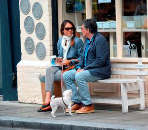 Gabriel Byrne and his wife outside Blazing Salads in Dublin