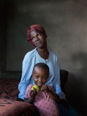 Mother of two Hlengiwe (who has cerebral palsy and HIV) with her four-year-old daughter Bagcinile in a township in Swaziland. Photo: Clare Keogh