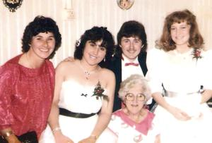 Andrea Smith, second from left, in her white dress and rebel black bow.