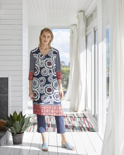 Printed kaftan with three-quarter length sleeves, V-neck and side splits in 100pc viscose, €69; linen trousers with elasticated waist, €59; leather mule, €99