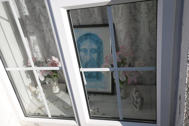 Isolation: A religious image in the window of Bridget Crosbie's home in Wexford town where her body was found after more  than two months. Photo: Pat Moore.