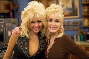 Pals: Miley Cyrus with her godmother Dolly Parton
