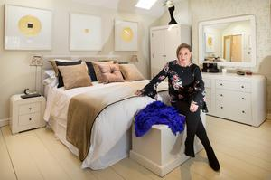 Magazine magnate Norah Casey in her newly decorated bedroom. The starting point for the colour scheme was the trio of Patrick Scott pictures over the bed. The bespoke headboard, curtains and bed throws are from House & Garden Furnishings. Photo: Tony Gavin