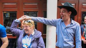 Ryan Tubridy dances with a fan outside the Gaiety