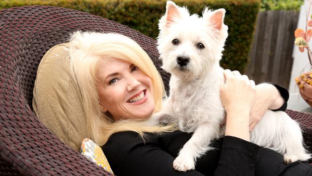 Daydream believers: Author Tracey Cleantis with her new found love, her dog Lily