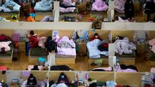 Patients infected with the coronavirus take rest at a temporary hospital in Wuhan this week. Photo: AP