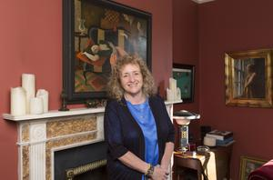 Chantal O'Sullivan in her South Dublin period home. She sourced the 18th-Century marble mantlepiece herself. The Cubist-style painting dates from the 1960s; Chantal likes to mix furnishings and accessories from different periods. Photo: Kip Carroll