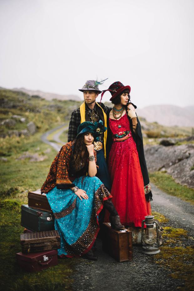 Sonia, left, wears: Jacket, €32, On The Verge. Scarf top, €50; hat, €85, both Alice Halliday. Vintage skirt, €65; shoes, €36, both Diesel, Liberty & Jasmine. Velvet cloche (worn underneath other hat), €130, Sannainspires. Cuffs, from €15, Skibbereen Farmers' Market. Rutilated quartz sterling-silver ring, €366, Jorg's Goldsmith Studio. Serpentine, quartz and lava stone sterling-silver necklace, €85, Hummingbird Jewellery. Tights, €5, Dunnes Stores. Ricky, centre, wears: Jacket, €99, D&G, TK Maxx. Shirt, €65; trousers, €44, both Liberty & Jasmine. Tweed and velvet fedora, €165, Sannainspires. Scarf, €5, St Vincent De Paul charity shop. Obi, €50, Alice Halliday. Ana, right, wears: Kimono, €95, On The Verge. Dress, €220; gloves, €20; necklaces, from €15, all Liberty & Jasmine. Hat, €180, Sannainspires. Obi, €40, Alice Halliday. Gemstone ring, €99, Aoife De Burca, Wild Design. Copper bracelet, €25, Paddy McCormack. Bangles, from €1; choker, €5, all Lisheens House charity shop.Quartz, carnelian and pyrite earrings, €28, Hummingbird Jewellery