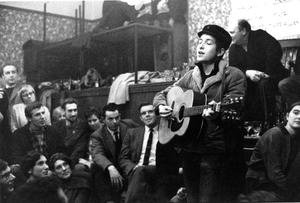 Dylan performing at the Singers Club Christmas Party on his first visit to Britain in 1962