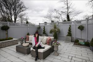 "Nikki in her beautifully paved garden. ""Joe from Platinum Paving Dublin was truly amazing. I had it all planned out on a spreadsheet, but he came to me during the renovation with ingenious little changes that made it much better,"" says Nikki. She trims the topiary hedges herself"