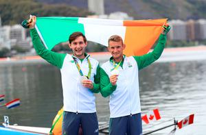 Ireland's Gary O'Donovan (right) and Paul O'Donovan (left) celebrate winning silver in the Lightweight Men's Double Sculls Final at The Lagoa Stadium on the seventh day of the Rio Olympic Games, Brazil