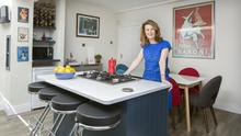 """Author Christine Dwyer Hickey in her colourful kitchen. There's a lot of wine on the rack, but Christine herself doesn't drink, she is a great party giver. Not in the shot is the essential bookcase, full of poetry books. """"I like to read poems when I'm boiling the spuds,"""" she says"""