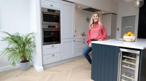 Bronagh in her extended kitchen. The pale-grey units are from Woodie's. For contrast, she had the solid-wood island painted navy, and the quartz worktops are from Miller Brothers