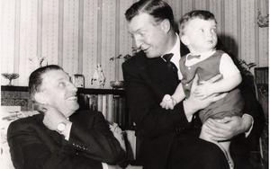 Remembering the Rising: Séan Lemass talks to Charles Haughey, who is holding Séan Haughey