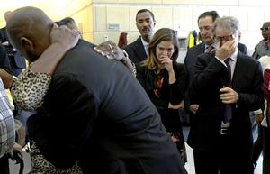Exonerated: John Nolley hugs family members as Emily Pelz, centre, and Barry Scheck, right, of the Innocence Project legal team wipe away tears in 2016 in Fort Worth, Texas. Nolley had been found guilty of murder in 1998