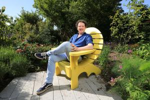 Diarmuid Gavin relaxes in his garden at his home in Co Wicklow. Photo: Frank McGrath