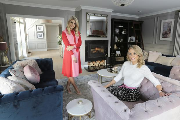 Vanessa (left) and Lisa Creaven in the formal living room of Vanessa's home. It's decorated in cream and navy — the navy sofas are from EZ Living Furniture, while the marble-topped tables are from Arnotts. Photo: David Conaghy