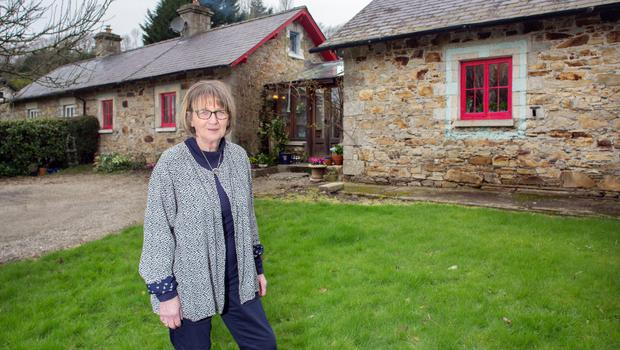 Deirdre outside her home. Dating over 100 years, it was part of a row of stone cottages which originally housed workers at the Fitzwilliam Estate