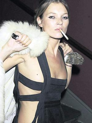 Kate Moss with a cigarette on a night out