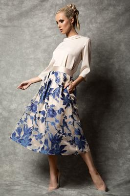 Fee G circular blue skirt, €210, worn with cream roll-neck top, €128. Photo: Eilish McCormick