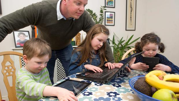 Graham Clifford monitoring his children's internet access, Aodhain (3), Aoife (6) and Molly (8)