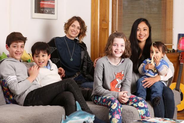 Happy families: Michele and Rina with their children. Photo: Clara Molden
