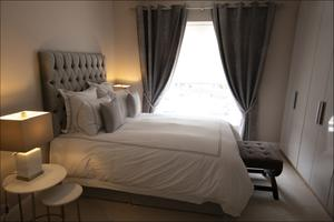 Nikki calls this guest room her Dunnes Stores room - the headboard is by Carolyn Donnelly, the bed linen is by Francis Brennan and the lamps are by Helen James, all designers with Dunnes Stores