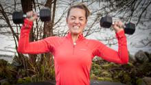 Let's get physical: Kathryn Thomas gets stuck in with some weights