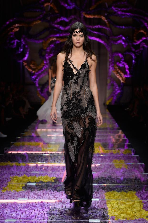 Credentials: Kendall Jenner has proved her fashion worth by walking for the likes of Atelier Versace at Paris Fashion Week