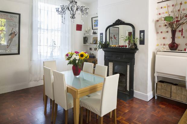 The dining room has a parquet floor and an original mantelpiece, one of the many features Mariam fell in love with when buying the house. Photo: Tony Gavin