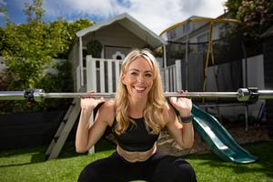 Power house : Personal trainer Andrea Bracken working out at home. Photo: Mark Condren