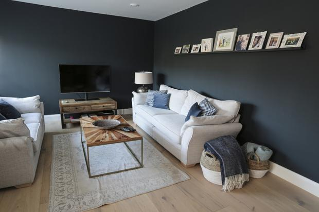 The cosy living room off the kitchen where Vanessa and her husband Barry like to chill. The wide floor planks were sourced abroad by Lisa's husband Patrick