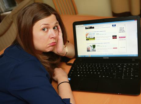 Chrissie Russell scours her laptop for a suitable home to buy. Photo: Ronan Lang
