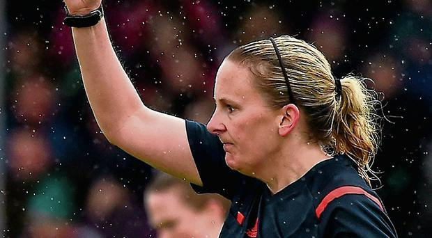 Referee Rhona Daly shows the red card