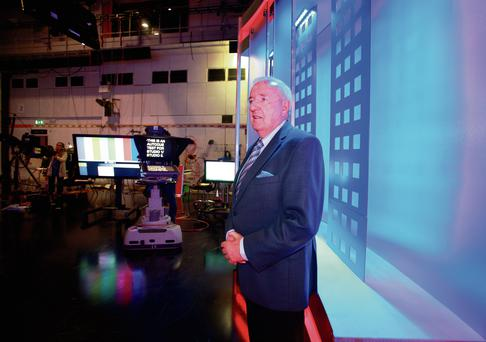 Bill O'Herlihy prepares for another broadcast in RTÉ before the veteran broadcaster calls time on his illustrious career with World Cup 2014 coverage. Photo: Ronan Lang.