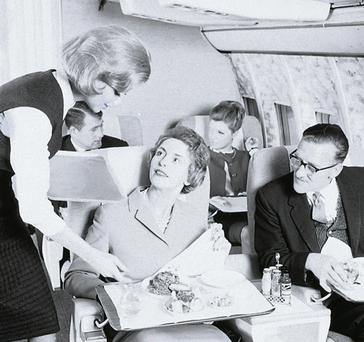 Living the high life: First class cabin service in the 1960s.