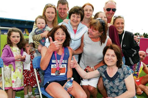 Céad Míle Fáilte: Mary B Jennings surrounded by her family celebrating in the RSC after finishing her 100th marathon – the Waterford Viking Marathon – last Saturday. Photo: Noel Browne