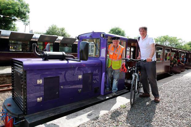 Kim Bielenberg at Waterford and Suir Railway, Kilmeaden, Co Waterford, with volunteer driver, Stephen Smith.