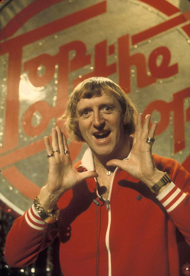 'He described it as being like the cork on the breaking wave' - Savile says of Top of the Pops, pictured here presenting the show.