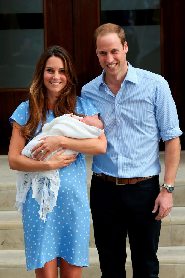 Kate Middleton and Prince William leaving hospital with their new baby George