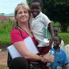 Labour of love: Jackie Pallas on the ground in Africa.