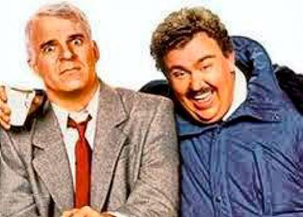 John Candy (left) who infuriates Steve Martin when they are forced travel companions in the film 'Planes, Trains and Automobiles'.