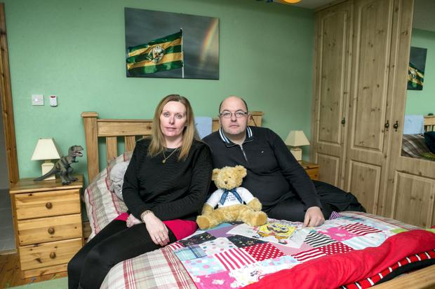Tony and Mary Heffernan sitting on their son Liam's bed where he passed away in 2014 from Battens Disease. His sister Saoirse died in the room next door from the same disease in 2011.