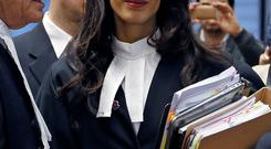 Human rights lawyer Amal Alamuddin Clooney, arrives with her colleague Geoffrey Robertson to attend a hearing at the European court of Human Rights in Strasbourg
